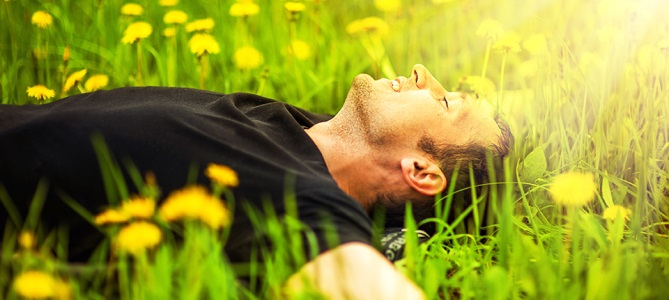 Man-Lying-on-Grass-669x300
